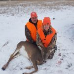 Volunteer Kevin Szachury and Tara Pettit with her first deer as the Dryden District Conservation Club and Dryden Rifle and Pistol Club hosted its first WOW (Women's Outdoor Weekend) to introduce women to a range of activities.