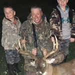 Mime Lint of Selkirk harvested this big buck before getting photos with sons Brayden and Brody.