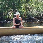 Francine D Batog of Geraldton lands a walleye in the Steel River.