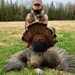 Trevor Okum of Renfrew submitted this photo of his son Brayden with a turkey.