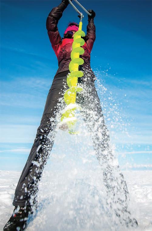 angler cutting ice fishing hole
