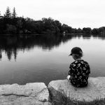 Brady Kuehl's six year-old-son, Wesley, waits for fish in the town of New Dundee last summer.