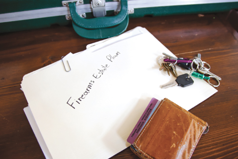 Documents on a desk with a briefcase, keys and a wallet