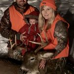 Jessicah McCann of Perth celebrated her first muzzleloader harvest with family James Mullins and their two-month-old daughter.