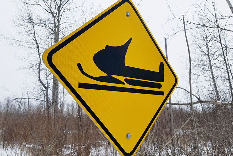 a snowmobile trail sign
