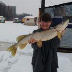 Ron Kaine of Orléans took this memento of wife Alexis' first through-the-ice-pike before returning it to the water.
