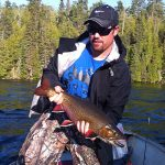 Ryan Brown of Port Elgin now reminisces about catching this 26-inch brookie on his annual fishing trip.