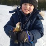 Tyler Duffy and son, Easton, of Godfrey enjoyed some steady perch action, leaving Easton hooked on ice fishing.