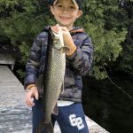 Benjamin Cooper of Georgetown caught his first lake trout off a dock in Haliburton.