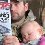 Chris Mink of Chatsworth caught up on some reading while Grace took a nap.