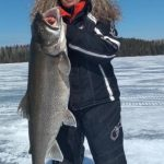 Loretta Bilous of Dryden caught this giant lake trout with a friend on a 10-lb test line through an eight-inch hole in northwestern Ontario.