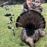Shannon Kelly of Napanee shows off her bow-harvested 23-lb tom to her daughter, Bailey.