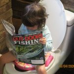 Canadian Armed forces retiree, Terrence Fader of North Lancaster, provided three-year-old granddaughter Georgia some reading material for her potty training.
