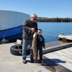 Larry Zimmerman of Evansville took his six-year-old grandson, Jacob, fishing on Cook's Dock. Jacob caught this 18-lb, 41-inch long pike on opening day, on a Williams Wobbler; the boy is now hooked on fishing.