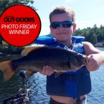 Photo Friday winner, Angus Adams, 7, of Tiny caught two beautiful smallmouth bass while fishing in 60 feet of water on Six Mile Lake with mom and dad. This four pounder was the larger of the two, and dad was very proud.