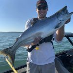 Ben Grieve of Thunder Bay enjoyed a beautiful morning trolling for salmon on Lake Superior with his son Kaleb, who caught and released this 11 pounder.
