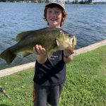 Charlie Arsenault of Kingston and son, Benjamin, 7, are now confirmed believers in Texas-rigged Senkos. Benjamin caught this 5.25-lb largemouth using a natural colour, beating dad's personal best by a pound.