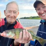 Jenn McRae of Long Sault had a great day walleye fishing on the river with her father, John Mason, despite this perch's cameo appearance.