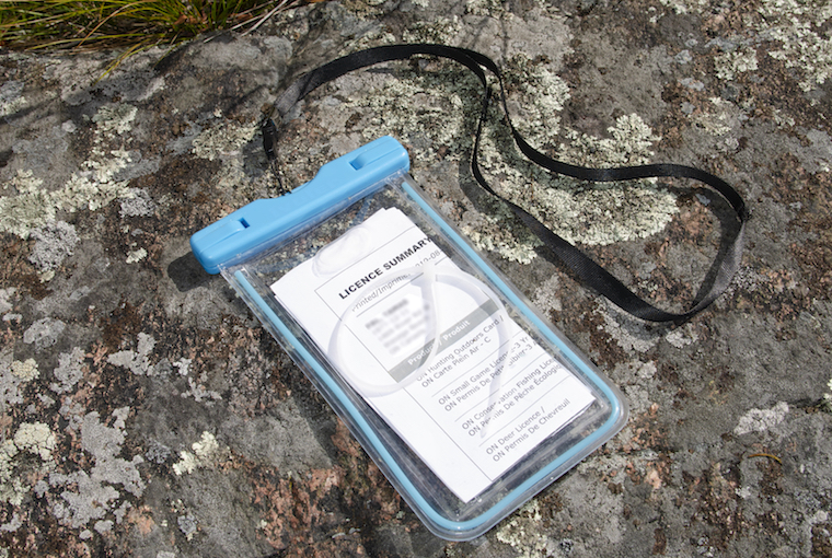 a plastic licence holder on a rock