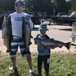 Chris Wdowiak of Sudbury and his nephew, Marcus Miller, 6, won first place in the Manitoulin Salmon Shootout; it was a day they'll never forget.