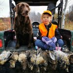 Charlotte Sinclair of Sault Ste. Marie had a long day hunting with family, as her daughter Arianna and their pup, Gunner, can attest.