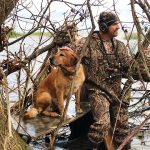 Craig Hall of Wyoming loves duck hunting, but his 4-legged friend lives for it.