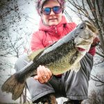 Amy Klassen of Waterford caught this largemouth in a small pond inBrantford; the 21-inch, 5-lb, 10-oz catch earned her a masterangler pin from the OWA.