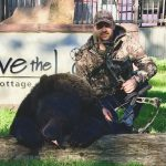 Stuart Huggins of Chatham harvested a 400-lb spring bear at eight yards using a compound bow at Olive the Lake Lodge in Marten River.