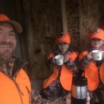 """Patrick Wylie of Lanark and his girls, Hannah and Margot, enjoy some hot chocolate in the """"deer fort"""" within the Lanark Highlands of the 2020 rifle season."""