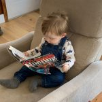 """Corey Fortier of Bobcaygeon snapped this candid pic of his son Nolan, 1 ½, who is an avid reader of Ontario OUT of DOORS. He loves flipping through the magazine, pointing at the pictures, and saying his new favourite word: """"deer."""""""