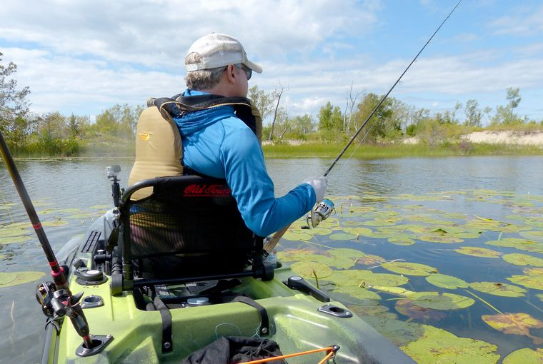 An angler fishes for bass from a kayak