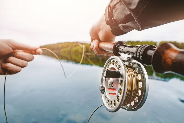 Fly rod and line in the hands of angler