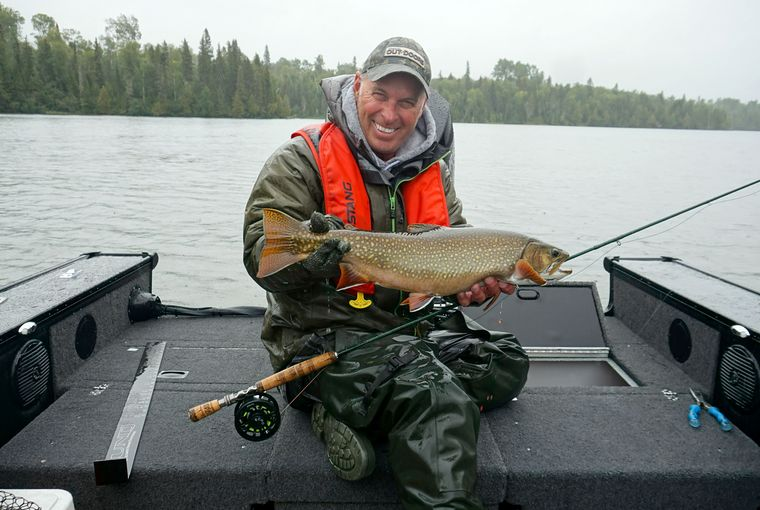 Gord Ellis with a big brookie caught fly fishing in a downpour G Ellis photo