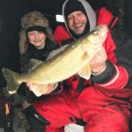 Adam Storer of Elmira spends most weekends fishing on Belwood Lake with his son Luke, who recently caught this 20-inch walleye.