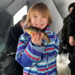 Amber McIsaac of Powassan shared this pic of her daughter Emily, who was having a ball catching perch on the South River in Powassan on a sunny day in January. She was using a gold and red Dinner Bell spoon with a minnow head and her favourite jigging rod!