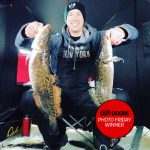 Photo Friday winner, Frank Kreisz of Orillia, shared this photo of his son Michael clutching a brace of burbot while ice fishing near Sioux Lookout.