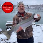 Photo Friday winner, Jeff Poulsen of Virgil, caught his first steelhead from the bank of the lower Niagara River on Christmas Day 2020 using a red and white streamer.