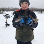 Stephen Foley of Cochrane shared this photo of Nicholas, 8, proudly holding his first splake.