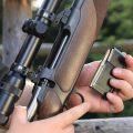 A Hunter loading his hunting rifle gun with magazine