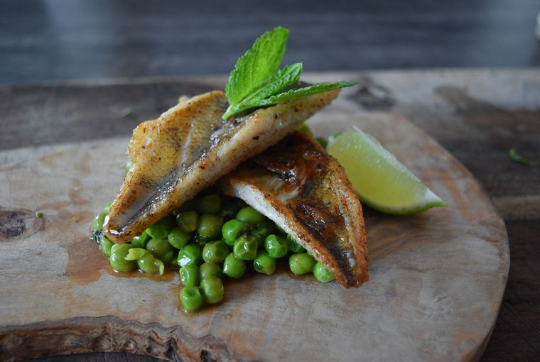 Pan-seared perch with green peas and mint