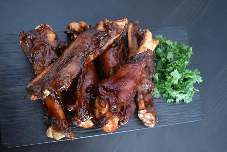Six wild turkey wings glazed in honey hot sauce