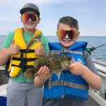 Blair Duhamel of Eden was trolling for pike with his boys on the Inner Bay of Long Point when his son Quintin caught this 11-inch rock bass on a three-inch floating jointed Rapala. His younger brother Lucien was happy to help by netting the monster into the boat.