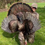 Jerrika Geneau of Strathroy proudly displays her first tom of the year harvested while hunting on her father's farm this spring. This is the first bird she called in and shot on her own.