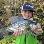 Max Calzonetti of Long Point enjoying wrapping up his spring crappie season at Long Point with his grandfather, David Martin. His smile says it all as he holds this 1.5-pound catch.