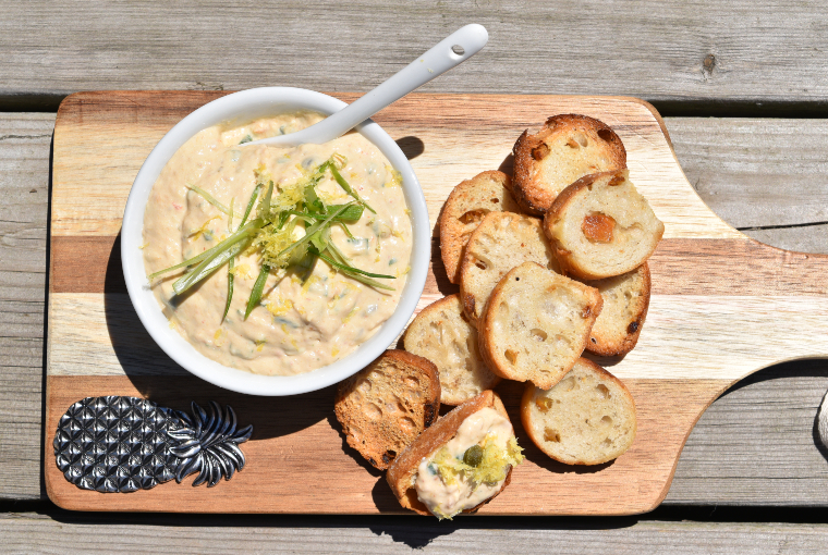 Smoked rainbow trout spread. (Bright and creamy-looking bowl of trout spread beside sliced bread)