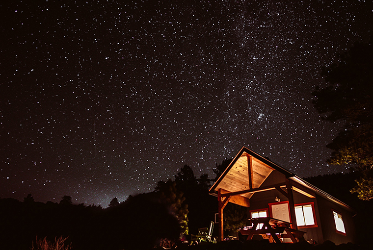 starry night over a small cabin