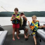 A July 2020 fishing trip in the Madawaska Valley got exciting for Graham Keller of Whitby when his daughter Charlotte cranked in her first largemouth bass. Her brother Emerson was there to help with the net.