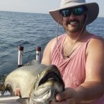 Bryan Head of Kingston went fishing on Lake Ontario 10 miles out from Newcastle on Playin' Hookey Fishing Charters with his dad and cousin. There, Bryan caught this 20.13-pound Chinook salmon.