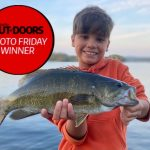 Photo Friday winner Joel Corda of Scarborough and son, Reggie caught this bass using a shallow running shad rap while fishing off the dock after dinner on Peninsula Lake. The smallmouth gave three good jumps before being netted, photographed, and released to leap another day.
