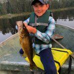 Erik Knutsen of Kingston was fishing with his nine-year-old son Kai [and Kai's Obi] on a secret lake near Quetico Park in northwestern Ontario, when Kai caught this walleye.